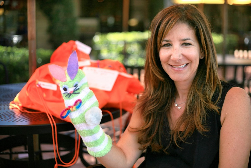 Project Solemates founder Leigh Donaldson Carman with a finished sock puppet. — Photo by Sara Hall ©