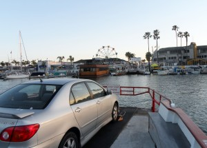 Balboa Ferry prepares to dock at the Balboa Fun Zone, a popular destination for tourists.