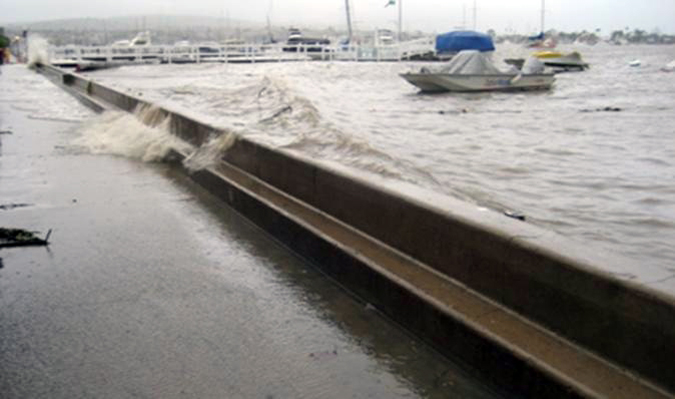 Water breaching a Balboa Island seawall in 2010. — Photo courtesy of city of Newport Beach
