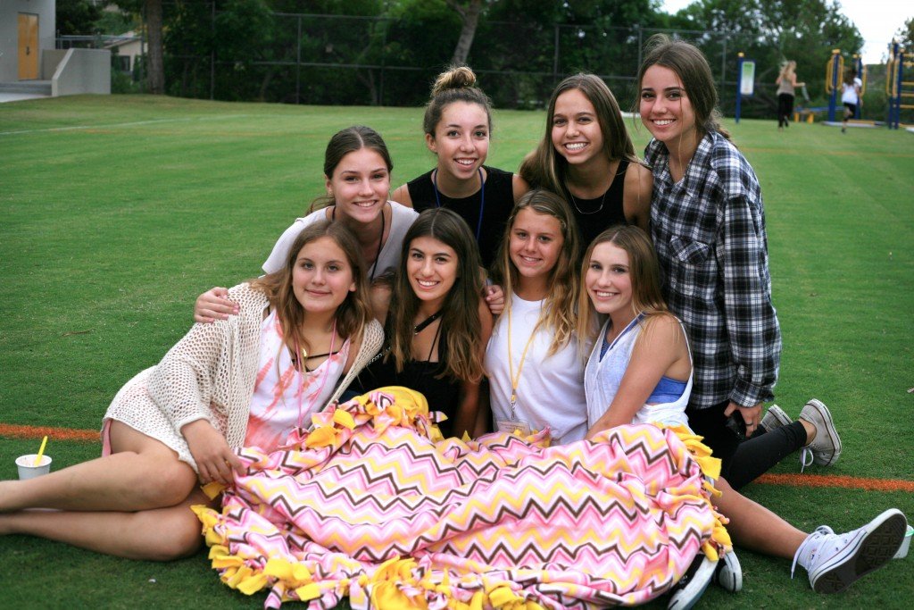 National Charity League girls pose for a photo with a blanket they made at Philanthropy Faire (top row, left to right) Corona del Mar freshmen Ellie Gehl and Kate Wirta, both 14, and sophomores Lauren Griffin, 16, also from CdM, and Liz Prado, 15, from Mater Dei. (Bottom row, left to right) Freshmen Mary Beeker from Mater Dei and Isabella DiGiorgio, Tessa Montgomery, and Natalie Young from CdM, all 14. — Photo by Sara Hall ©