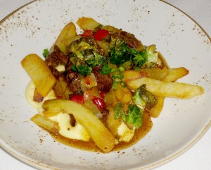 """Philadelphia,"" a cheesesteak dish with oxtail, house made cheese whiz, and Kennebec fries"