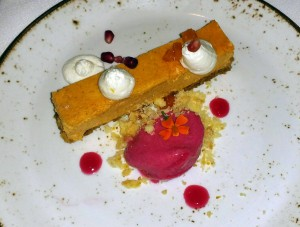 """Forty-Second Street"" butternut squash cheesecake with cranberry sorbet, vanilla Chantilly and pomegranate seeds"