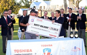 A check is presented to Duffy Waldorf