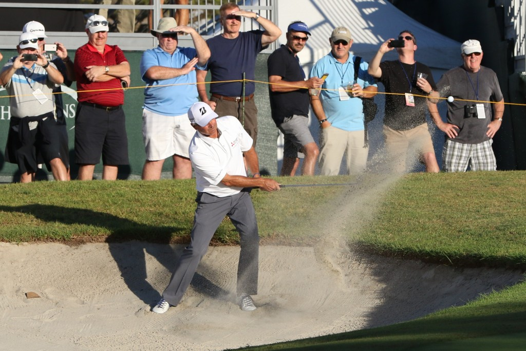 : Newport Beach resident Fred Couples blasts his way out of a sand trap
