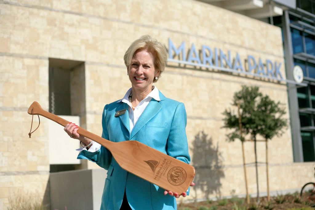 New Mayor Diane Dixon poses for a photo with a commemorative Marina Park grand opening oar on Saturday. — Photo by Sara Hall ©