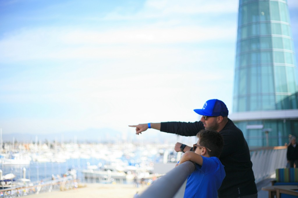 Peninsula residents Kev Haleblian and his son, Brandyn, 8, look out over the bay from Marina Park during the grand opening event on Saturday. — Photo by Sara Hall ©