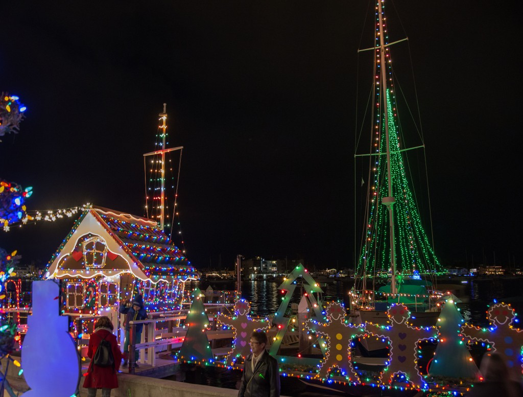 The life-size plywood gingerbread house, gingerbread men on the plank, and a large Christmas tree of lights on Vitarelli's dock. — Photo by Charles Weinberg ©