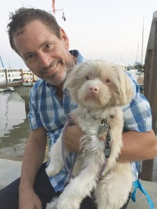 Wilbur, a Malti-Poo, and his human, Duffy Evans