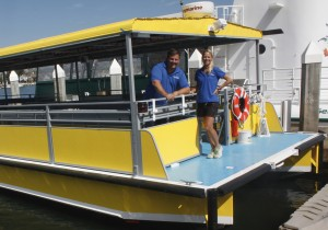 Former ExplorOcean CSO Tom Pollack, shown here with Wendy Marshall, PhD., director of education and public programs for ExplorOcean, aboard the new ExplorOcean catamaran.