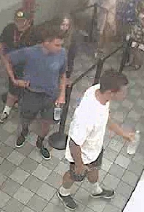 The leaf blower suspects were seen on video surveillance at the Newport Beach theater. — Photo courtesy Newport Beach Police Department©