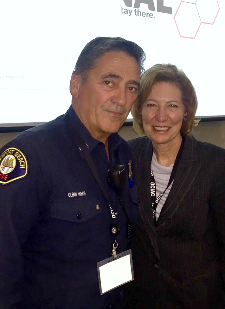Newport Beach Fire Department Captain Glenn White with Orange County Sheriff Sandra Hutchens. — Photo courtesy the Newport Beach Fire Department ©