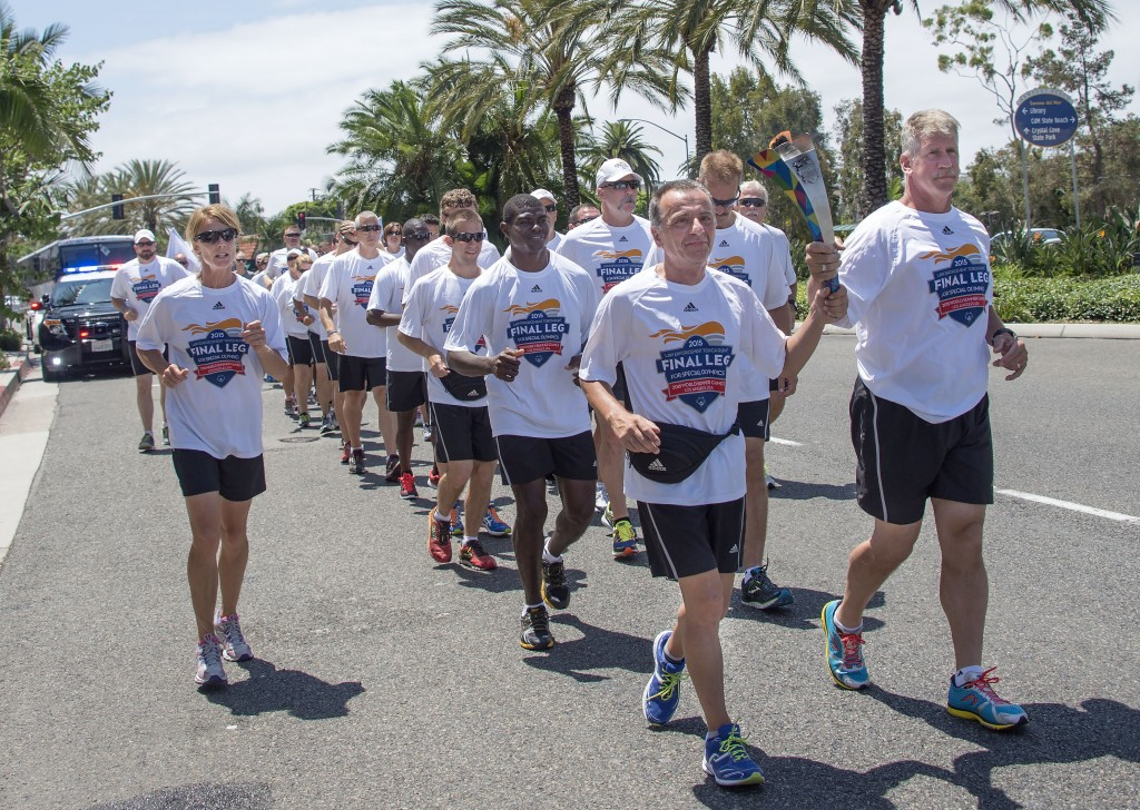 The Special Olympics Flame of Hope is carried along Coast highway through Corona del Mar — Photo by Charles Weinberg©