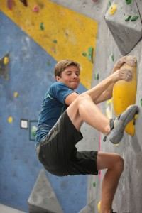 Garrett Keyes climbing a rock wall (photo credit: Diana Keyes)