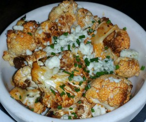 Roasted cauliflower with red hot pepper sauce and gorgonzola crumbles