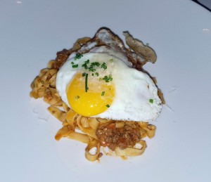 """Best Worst Mistake"" house-made tagliatelle, smoky Bolognese sauce, a fried egg, nd aparmesan,"