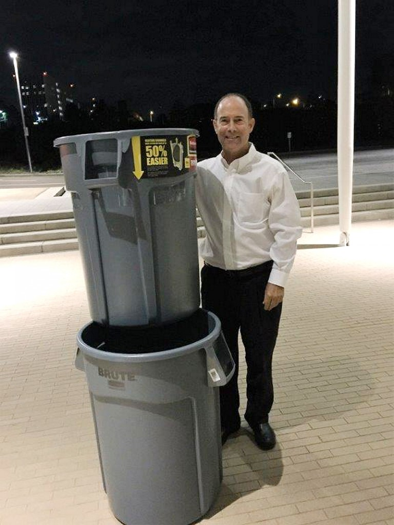 Bruce Horn with the trashcans he presented to the Planning Commission as a visual comparison to the size of the cell tower. — Photo courtesy Bruce Horn ©