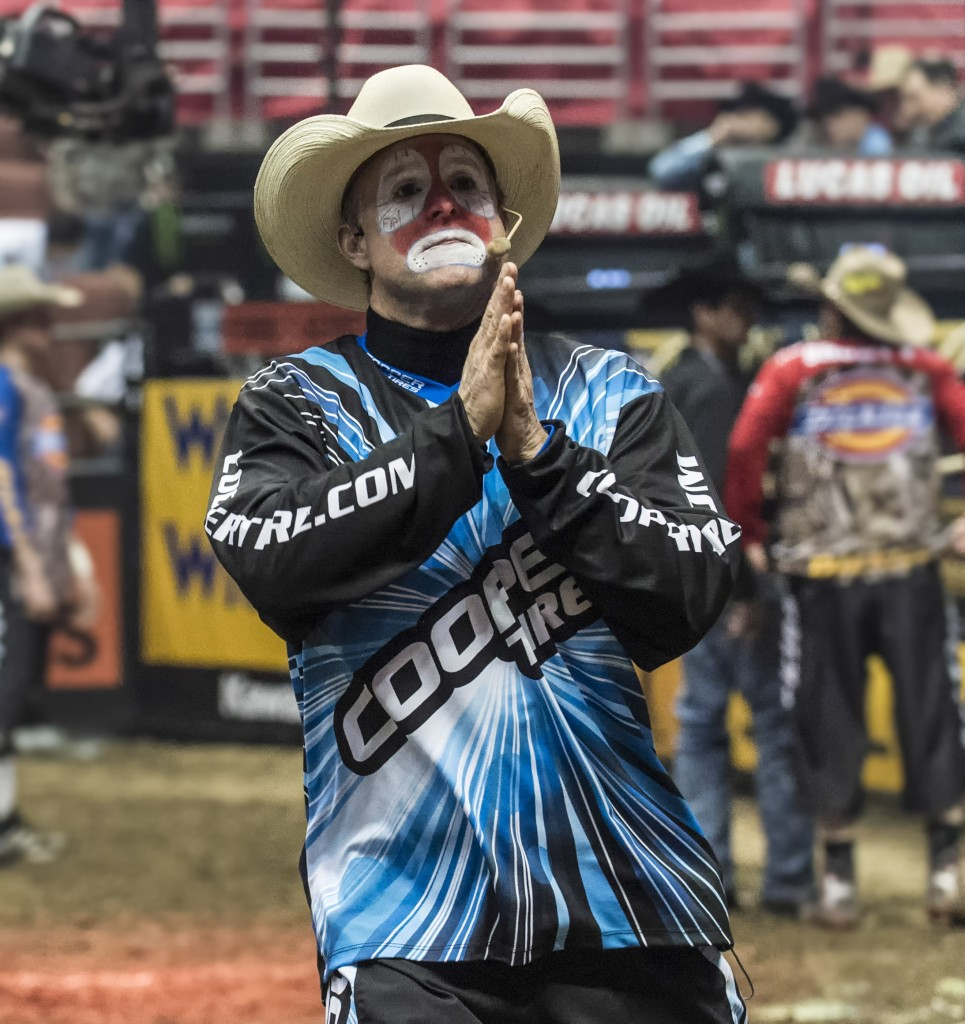 PBR Clown Flint Rasmussen gets in on the action. — Photo by Lawrence Sherwin ©
