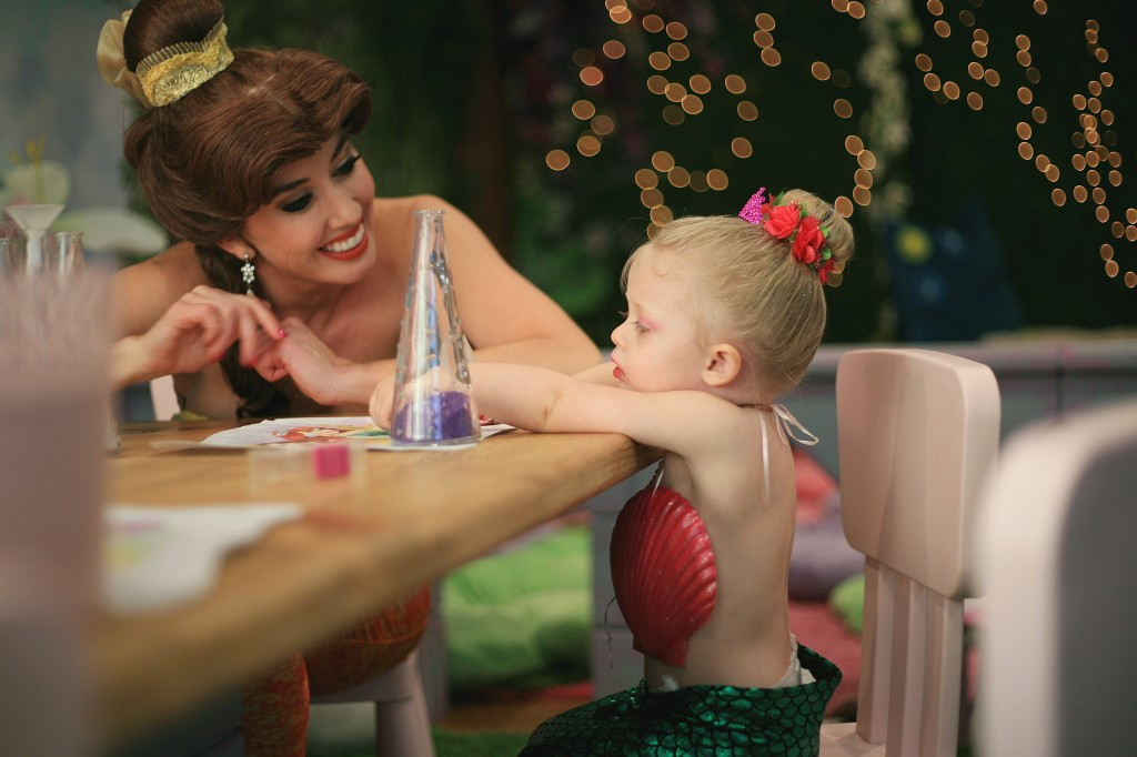 Princess Belle chats with Berlin Martin, 2, during Mermaid Monday at Once Upon an Island on Feb. 8. — Photo by Sara Hall ©