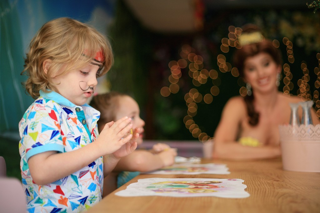 Landon Martin, 4, works on his bracelet as Princess Belle looks on during craft time at Once Upon an Island. — Photo by Sara Hall ©