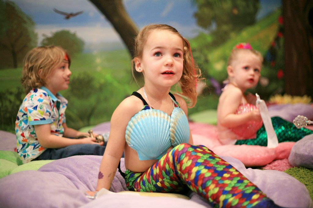 Skylar Amirpur, 3, (middle) gets excited as she sees Princess Belle as Landon, 4, and Berlin Martin, 2, look on in the background. — Photo by Sara Hall ©