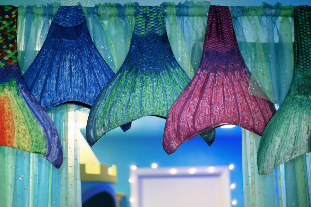 Mermaid tails hung up in the shop. — Photo by Sara Hall ©