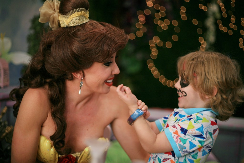 Landon Martin, 4, shows his bracelet to Princess Belle during craft time at Once Upon an Island. — Photo by Sara Hall ©
