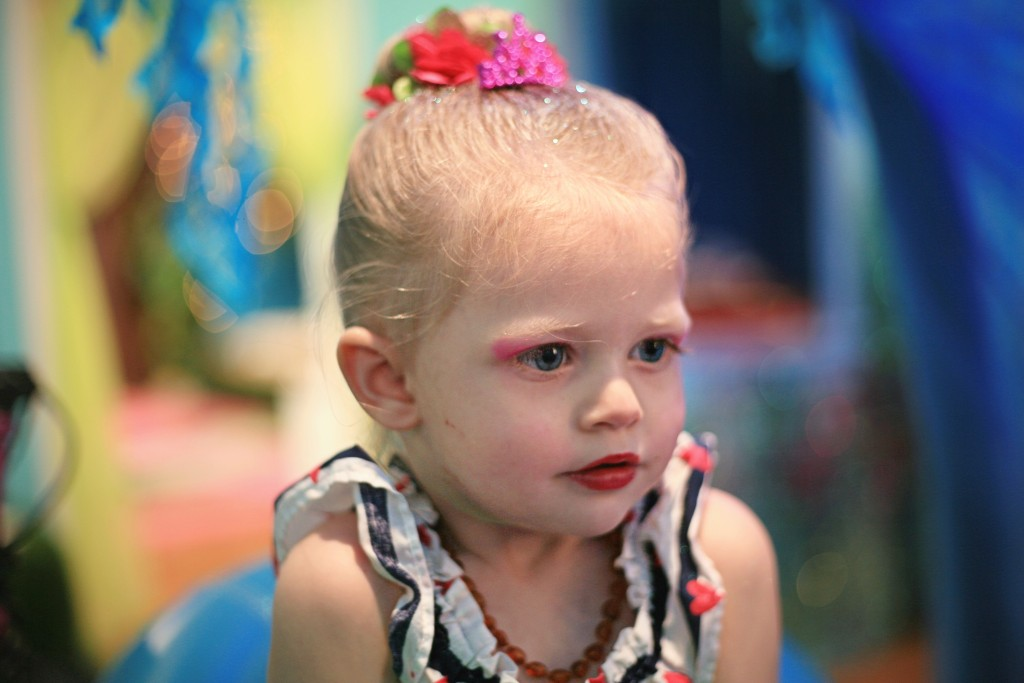 Berlin Martin, 2, checks out her mermaid makeup in the Jellyfish Salon at Once Upon an Island. — Photo by Sara Hall ©