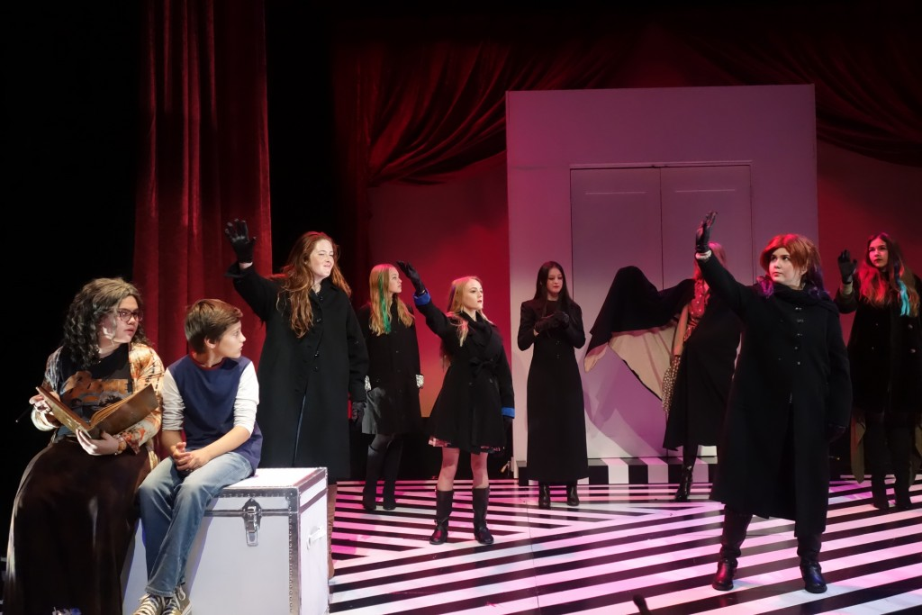 """Boy (Dominic Brack) and Grandma (Sarah Sparks) (front, left) look on as the witches perform during a dress rehearsal for the South Coast Repertory Junior Players' production of """"The Witches,"""" adapted for the stage by David Wood from Roald Dahl's novel. The show will be performed in the Nicholas Studio between March 12 to 20. — Photo courtesy South Coast Repertory ©"""