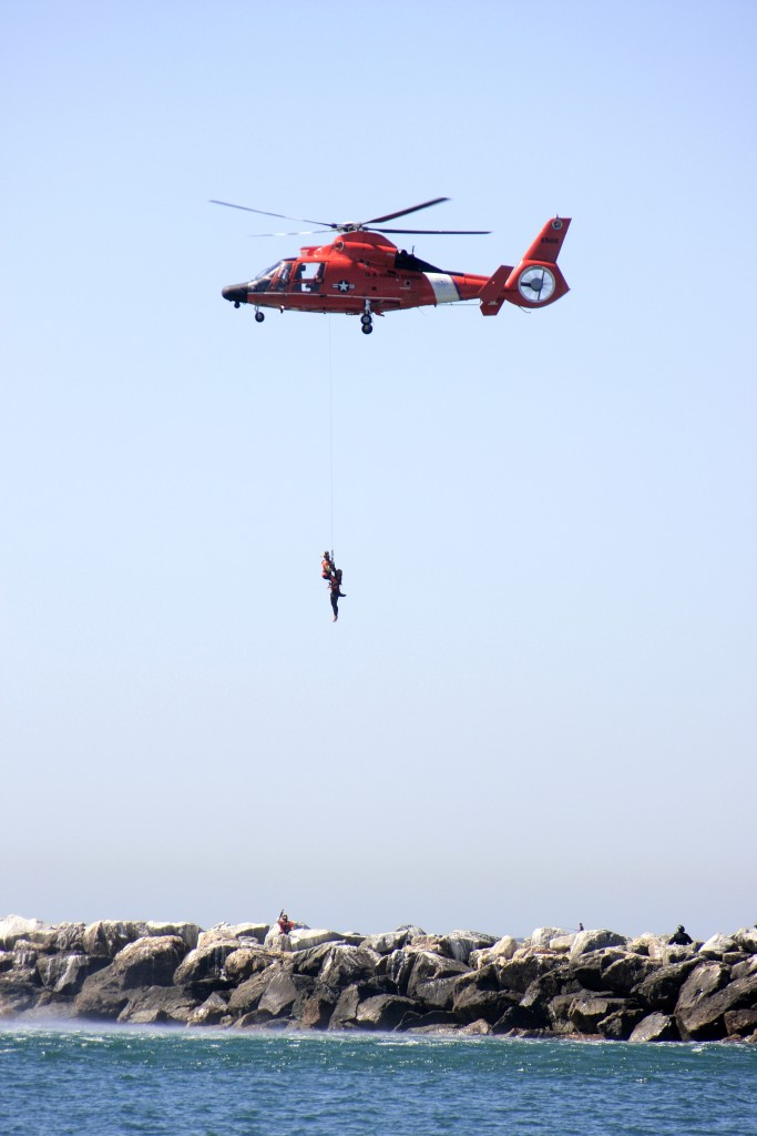 A U.S, Coast Guard helicopter makes a rescue off the jetty near Corona del Mar State Beach during the maritime disaster drill on Wednesday. — Photo by Sara Hall ©