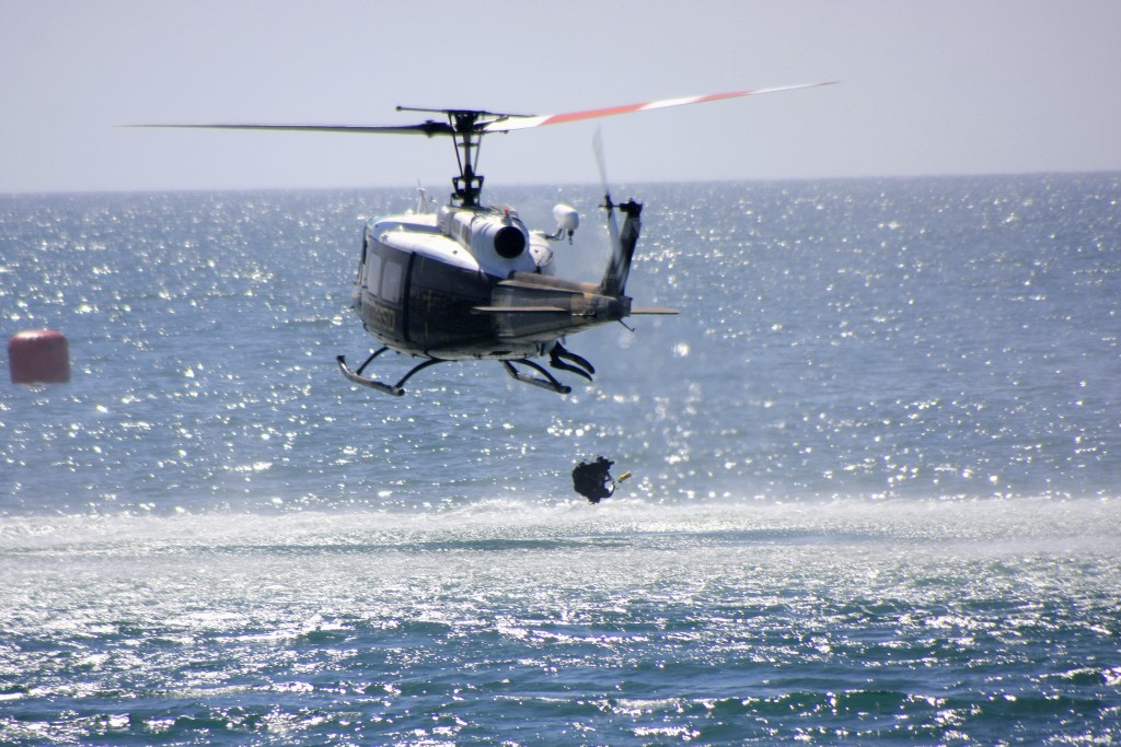 A diver drops from the Orange County Harbor Patrol helicopter during the disaster drill. — Photo by Sara Hall ©