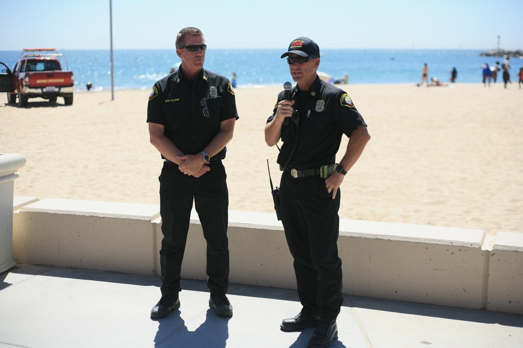 Newport Beach Fire Department Assistant Chiefs Rob Williams (left) and Chip Duncan, who organized the maritime disaster exercise, talk to the participants as the drill winds down on Wednesday. — Photo by Sara Hall ©