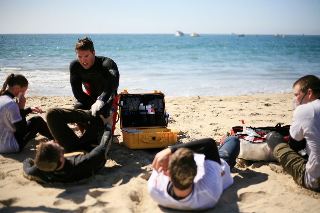 "The first ""victims"" of the mock disaster are treated by Newport Beach lifeguards. — Photo by Sara Hall ©"
