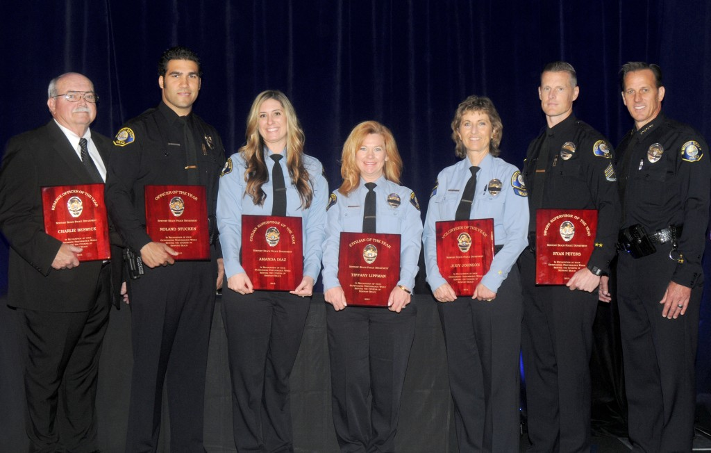 NBPD honorees (left to right): Charlie Beswick, Roland Stucken, Amada Diaz, Tiffany Lippman, Judy Johnson, Ryan Peters, and Chief Jay R. Johnson. — Photo courtesy NBPD ©