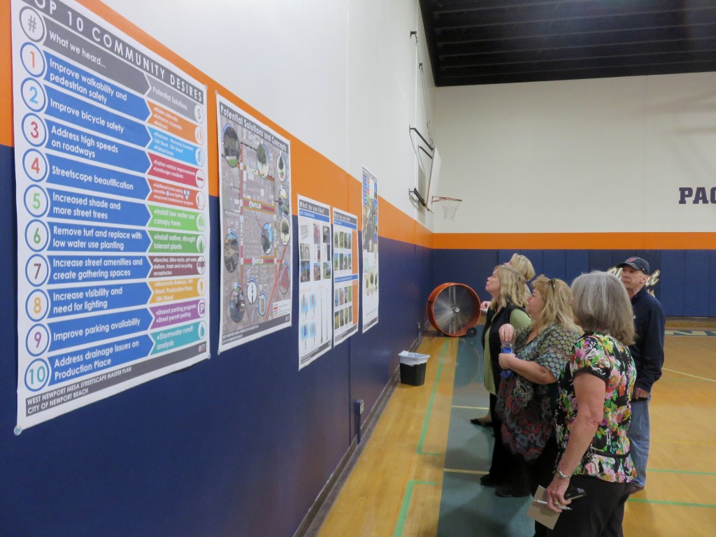 Residents check out the top community comments and concept ideas for the West Newport Mesa Streetscape Master Plan during a public workshop on Wednesday. — Photo by Sara Hall ©