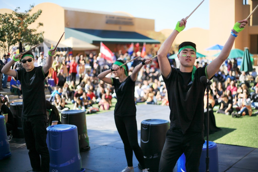 Sage Hill students perform Nanta drumming at the fair. — Photo by Sara Hall ©