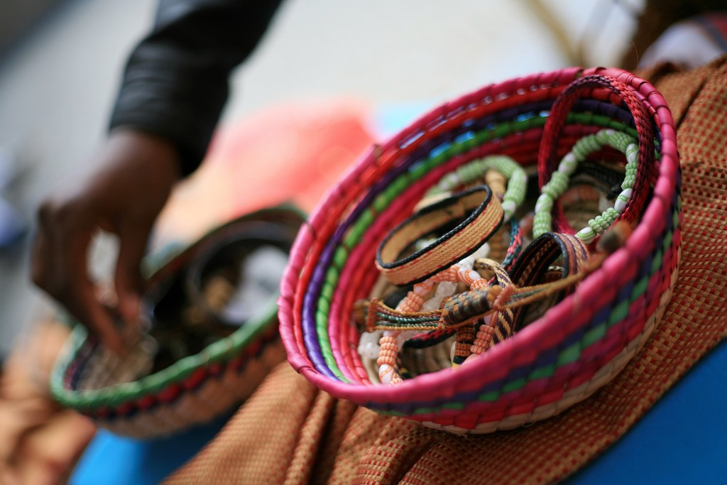 Laguna Niguel student Devonte Boos of the 100 Black Men organization looks through Tanzanian bracelets at the Ethnic Bazaar at the fair. — Photo by Sara Hall ©