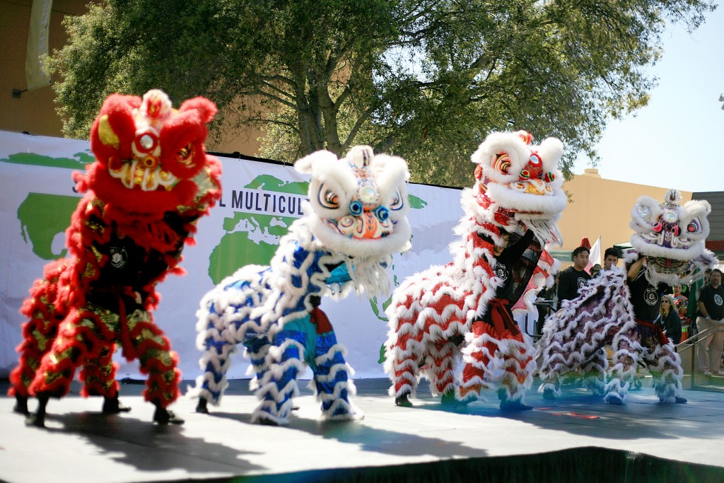 Traditional Chinese lion dancers from the Ane Thanh troupe perform during the 15th Annual Sage Hill Multicultural Fair on Saturday. — Photo by Sara Hall ©