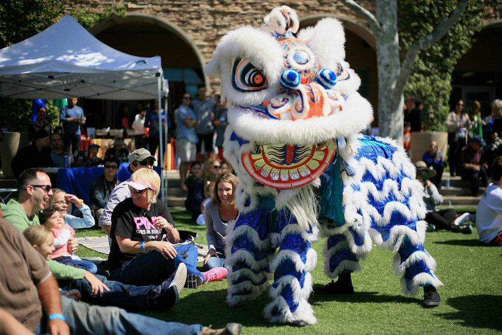 Traditional Chinese lion dancers from the Ane Thanh troupe interact with the crowd during the 15th Annual Sage Hill Multicultural Fair on Saturday. — Photo by Sara Hall ©