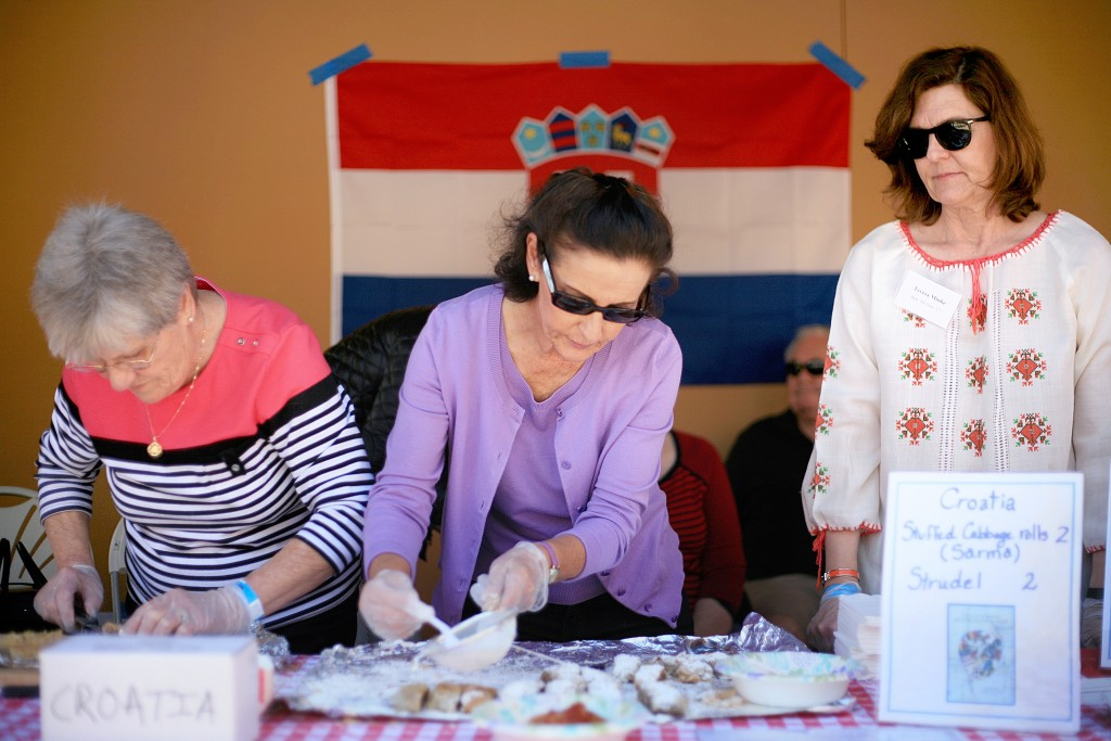 (left to right) Family members Bonnie Mihovilovich, Norma Chizek, and Teresa Minke help at the Croatia food booth during the Sage Hill Multicultural Fair on Saturday. — Photo by Sara Hall ©