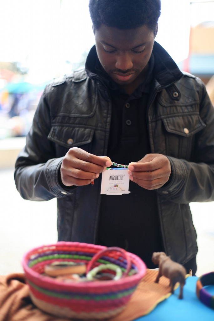 Laguna Niguel student Devonte Boos of 100 Black Men organization checks out some Tanzanian bracelets at the Ethnic Bazaar at the fair. — Photo by Sara Hall ©