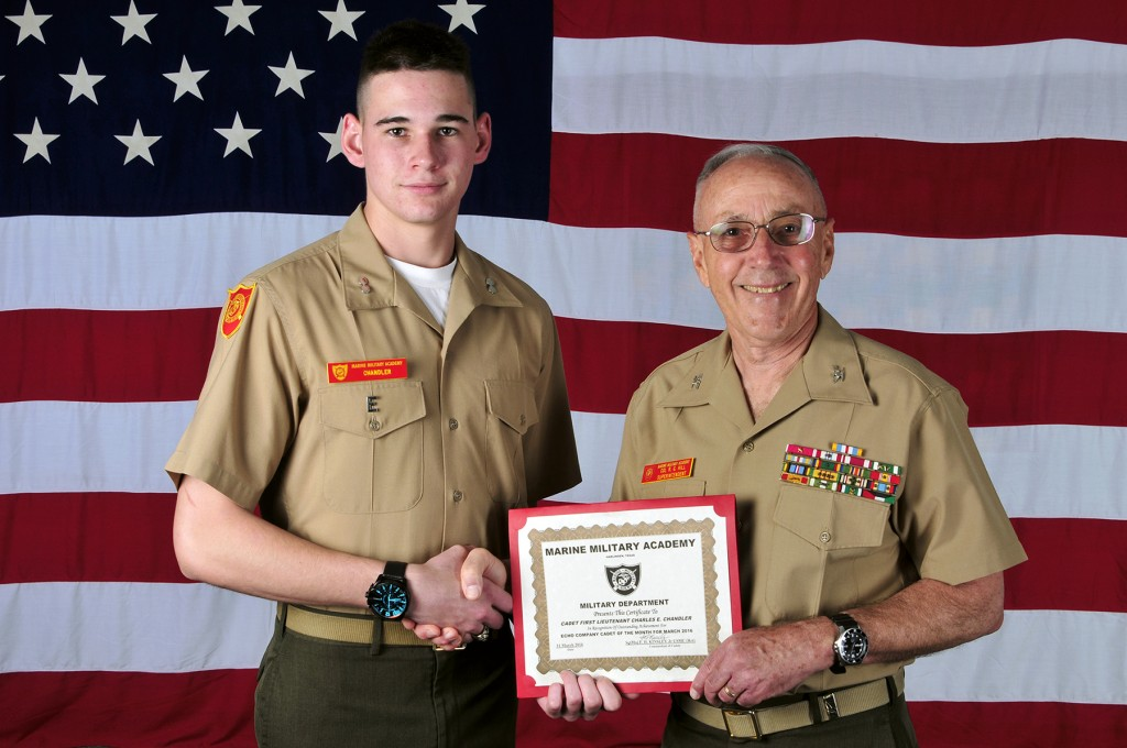Marine Military Academy senior Charles Chandler of Newport Beach accepts the Marine Military Academy March 2016 Cadet of the Month award from Superintendent Col R. Glenn Hill. — Photo courtesy Marine Military Academy ©