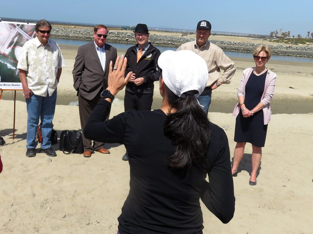 Local resident and dog beach opponent Vivien Hyman speaks to officials (left to right) Newport Beach councilmen Ed Selich and Keith Curry, Assemblyman Matthew Harper, NB Councilman Scott Peotter, and NB Mayor Diane Dixon during a press conference about the area on Saturday. — Photo by Sara Hall ©