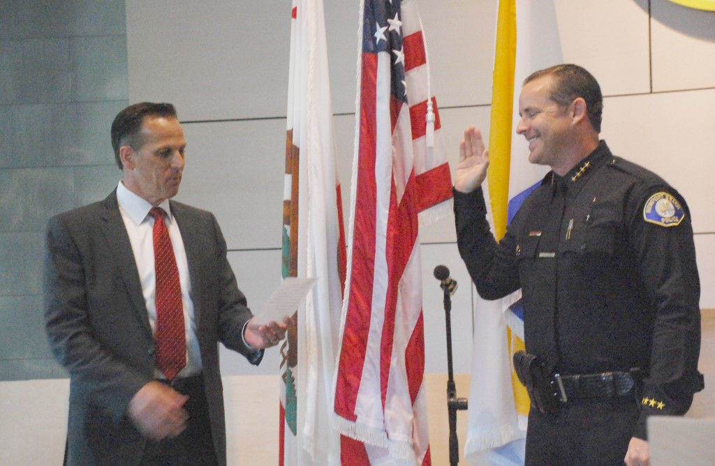 Jon Lewis gets sworn in as the new Newport Beach Police Department chief by the outgoing, retired chief Jay Johnson. — Photo by Daniel Langhorne ©