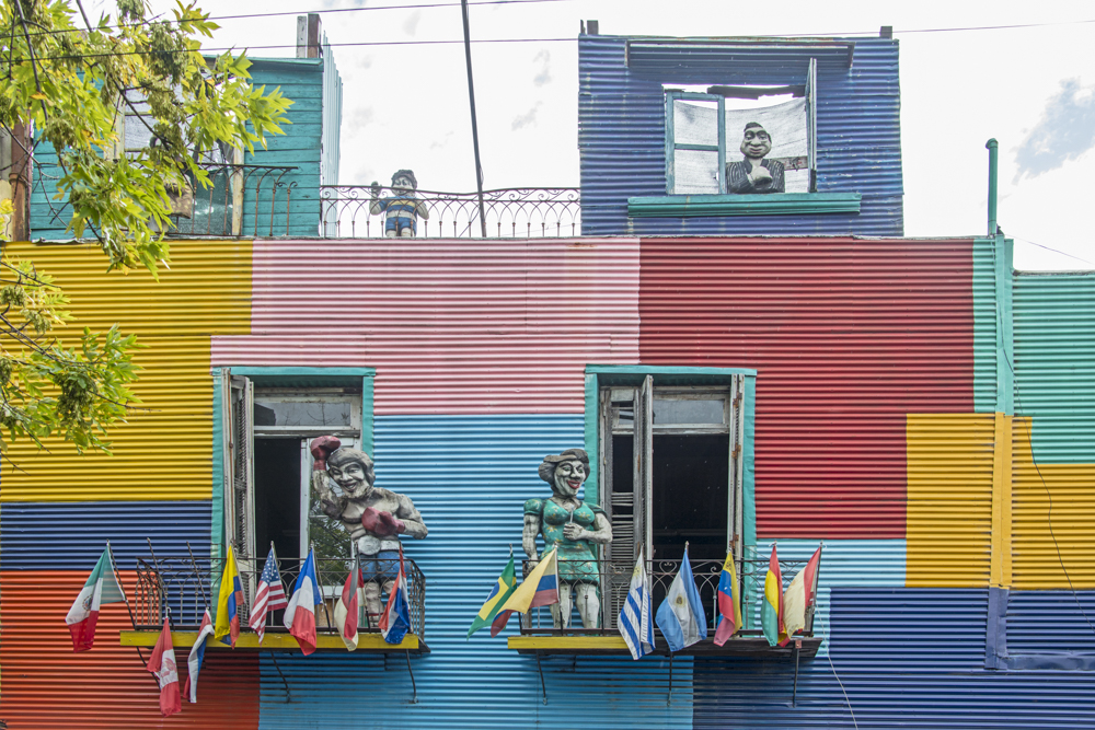 La Camanita in colorful La Boca has a cartoon like feel with mannequins and brightly painted corrugated metal buildings. — Photo by Lawrence Sherwin ©