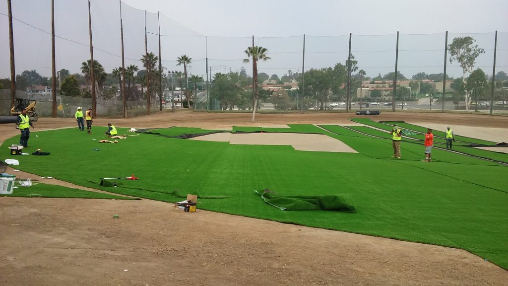 Synthetic turf gets rolled out at the Newport Beach Golf Club driving range recently. The turf is part of the club's remodel project. — Photo courtesy Newport Beach Golf Club ©