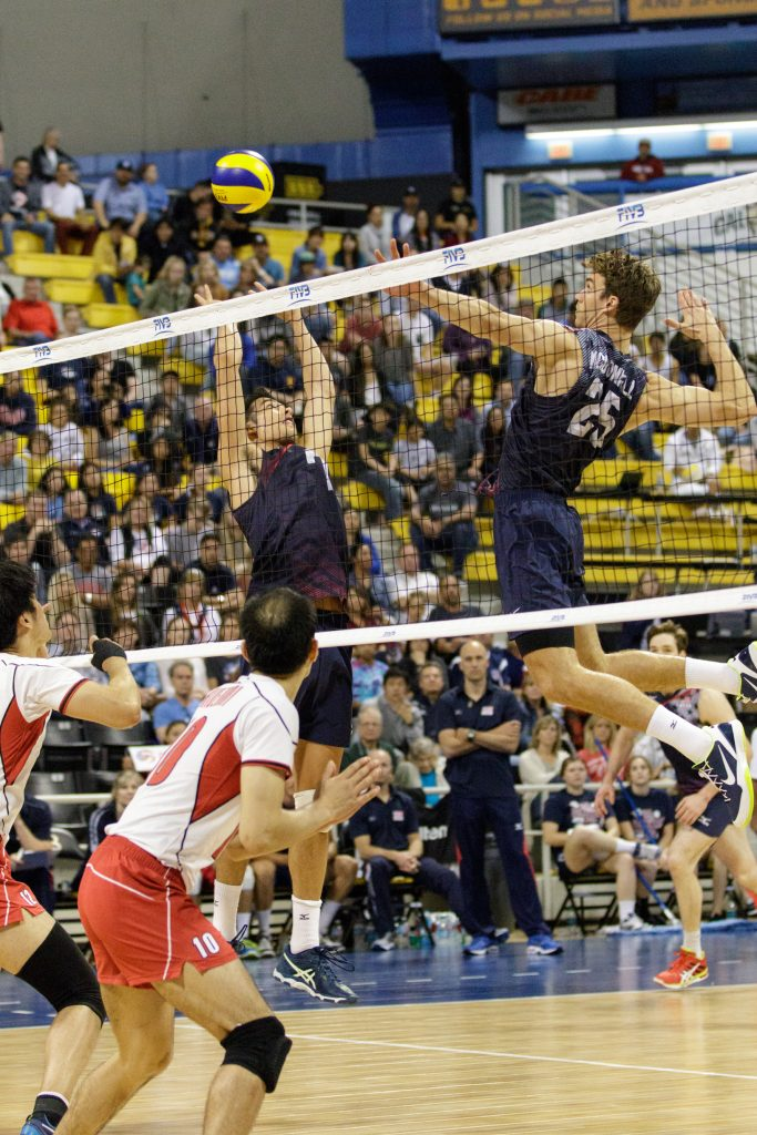 U.S. player Kawika Shoji (#7) sets up the ball as his teammate Dan McDonnell (#25) leaps to spike it against Japan. — Photo by Jim Collins ©