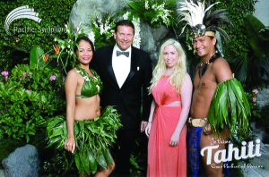 NB Indy writers Christopher Trela and Catherine Del Casale pose for a Tahiti postcard