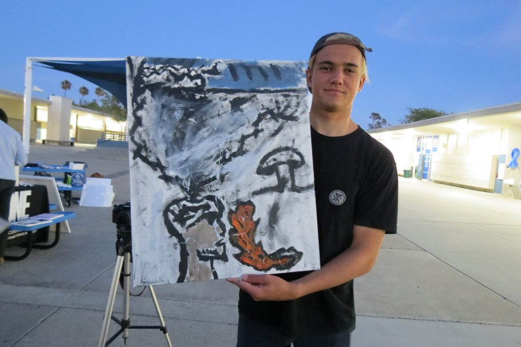 Skylar with the painting he created during a recent One Recovery meeting. — Photo by Elizabeth Greenberg ©