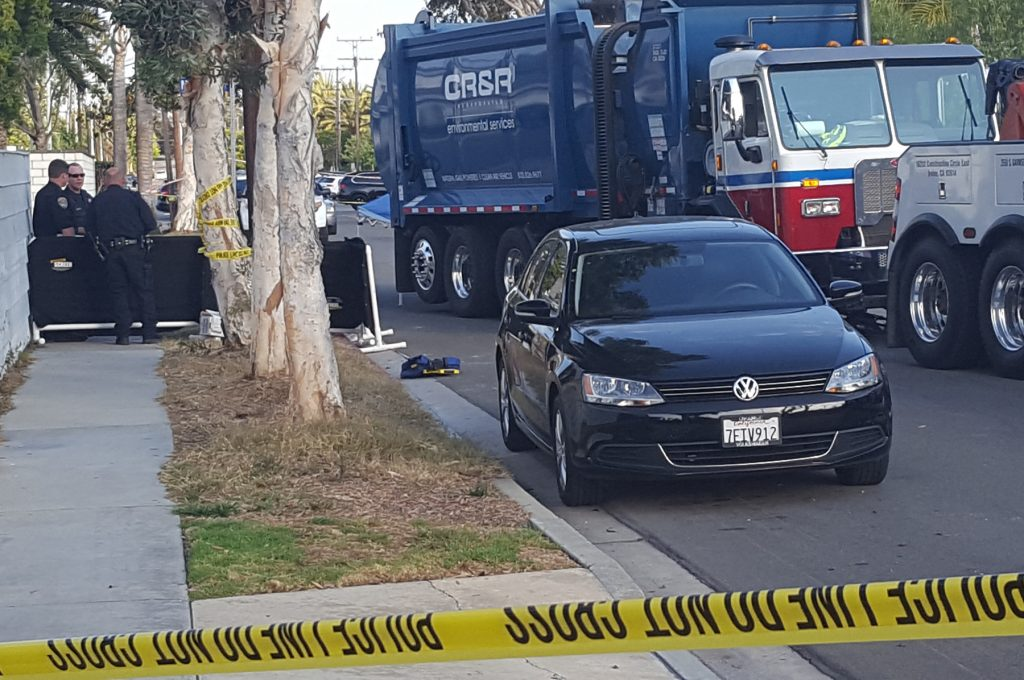 Police remained on scene where a trash truck hit an 8-year-old boy in Newport Beach for several hours after the accident. — Photo by Christopher Trela ©