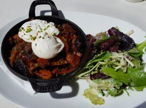 Zinfandel braised beef short rib hash & fried eggs with duck fat-roasted fingerling potatoes